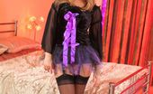 Only Tease Jodie Gasson Cute curvy blonde strips out of her halloween costume and looks a treat in her lilac lingerie and black stockings.