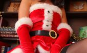 Only Tease Bryoni-Kate Dark haired beauty slips out of her sexy santa outfit and makes for a real Christmas treat.