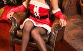 Only Tease Emma Glover Busty brunette celebrates Christmas in her stockings