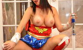 Tiffany Preston Tiffany is a bigtits super heroine Here is Tiffany getting really naughty for this 2011 Halloween guys , here she is teasing you in a wonder woman costume pulling of her huge tits for you and put her round bubble butt in the air for you and stretch it hard. Happy Halloween guys!