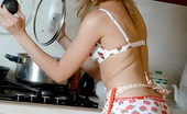 Club Seventeen Caroline Teen hottie strokes her smoking hot body in the kitchen