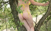 Club Seventeen Lucy Bikini wearing chick loves playing in a big tree outdoors