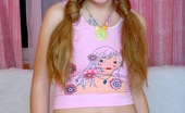 Club Seventeen Sasha Pigtails teenager caresses cooch with her soaked fingers