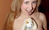 Club Seventeen Sasha 115605 Cute banana eating beauty rubs her tight soaked coochie
