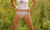 Club Seventeen Brunette teenie girl pleasing her pussy in a public field