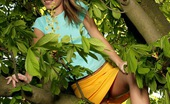 Club Seventeen Jana X Blonde teenage cutie shows her tight pussy in a big tree