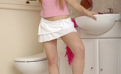 Club Seventeen Michelle A horny teenage cutie masturbating her clit on the toilet