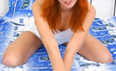 Club Seventeen Christine A hot teenage redhead stroking her snatch with a small dildo