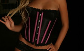Alluring Vixens Nikki Sexy Vixen Nikki Loves To Tease In Her Lace Corset With Matching Panties And Stockings