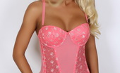 Alluring Vixens Bonus Vixens Busty Blonde Vixen Alysson Teases In A Tight Lowcut Pink Corset That Barely Contains Her Big Tits