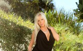 Aziani Sexy Busty Blonde, Eden Adams, Looks Stunning In Her Black Dress Posing Outdoors. Even Better Is When She Decides To Put On A Hot Striptease Revealing All Her Beauty!