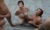 Mature.nl Two Mature Sluts Take On A Whole Bunch Of Cocks