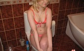 Young Libertines Slut Fingers Her Slit. Naughty Blonde Slut Fingers Her Slit In A Bathroom.