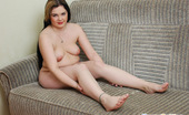 Young Fatties 148673 Fat Brunette Poses With Her Bare Hips Spread Wide