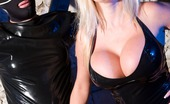 Michelle Thorne 151985 Latex Dungeon Mistress Thorne Is In The Dungeon Dressed In Some Very Tight Black Latex. She Has Her Horny Littie Gimp Chained Up And Exactly Where She Wants Him, So She Can Give His Cock A Really Good Smoking!