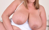 Busty Britain Carol Brown Plays With Her Huge Melons And Toy Rams Her Cunt