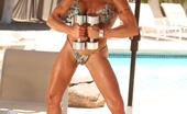 Aziani Iron Gina Gina Struts Her Toned, Ripped Up Body As She Poses And Flexes In Her Bikini.