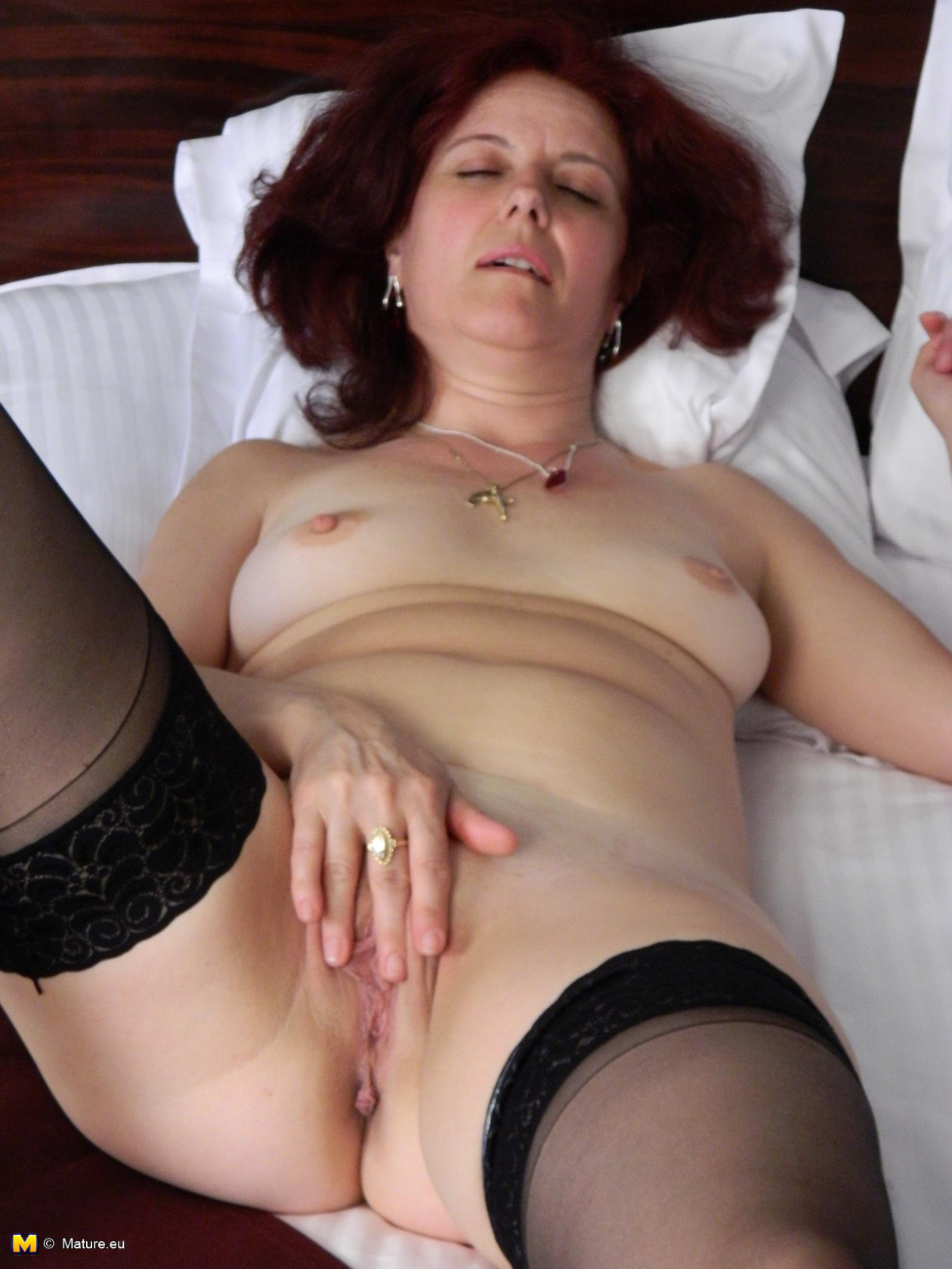 image Busty hot mature slut has a dick to survive