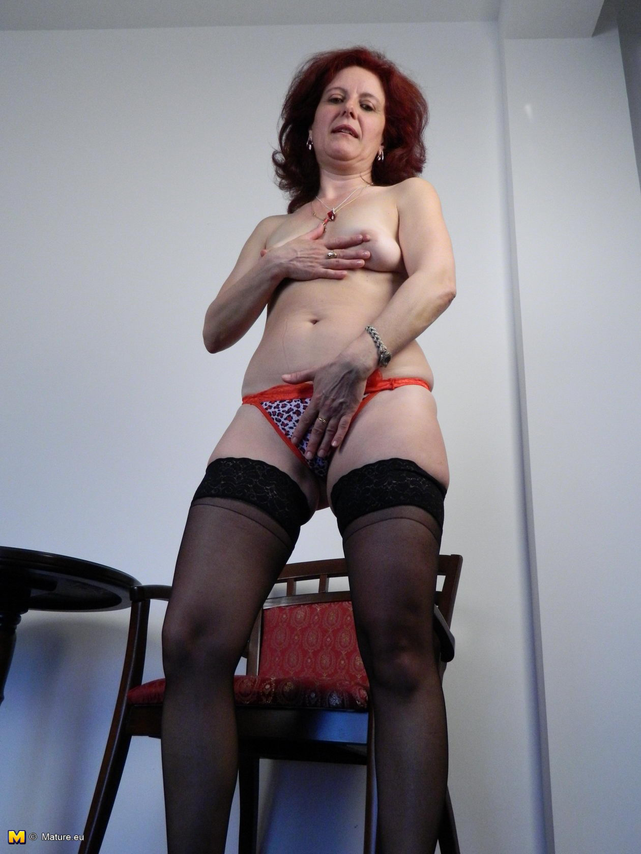 image Brunette slut loves getting fucked while sucking a cock