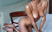 Erotic Beauty Divina A Peter Guzman My Place 2 Bombshell Brunette Divina A Sits On A Chair And Shows Off Her Exotic Tight Body.