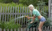Errotica Archives Juntarse Leonie With A Cute And Charming Smile On Her Pretty Face, Leonie Strips Off Her Shirt And Denim Shorts In The Garden Before Enjoying The Refreshing Cool Water From Th Garden Hose. Flora