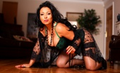 Just Danica Danica In Emerald Green Corset And Panties With Fishnet Stockings.