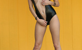 Nextdoor Models Autumn Black Latex Clings To Autumn, But She Manages To Get Her One Piece Off For Us!