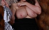 Georgina Gee Big Boobed Babe Squeezes Her Huge Boobs Into A Tiny Zebra Print Bikini