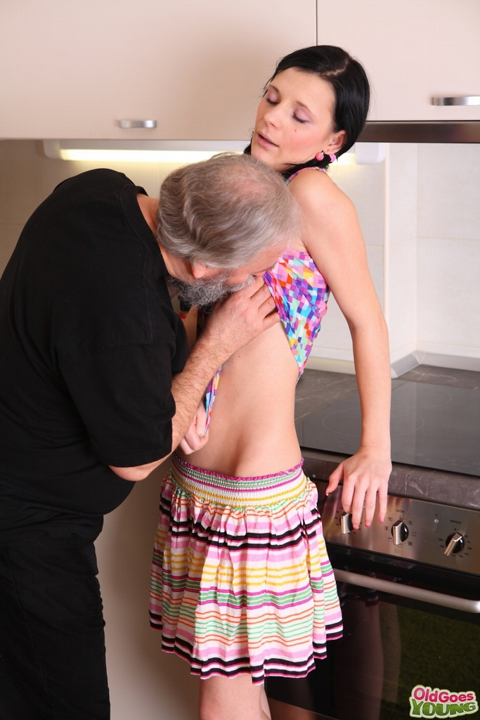 Karina kneels before both of her men and takes their cum all 8