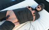 Electro Sluts Wenona gets mummified and stuffed with electric pussy plug. She takes the tazer on all her exposed skin while licking her mistress to orgasm.