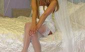 Stiletto Girl Sultry Blonde In White Stockings & Stilettos