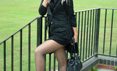 Stiletto Girl Beautiful Blonde Dressed In Black And Showing Off Her High Heels