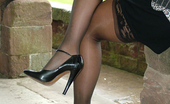 Stiletto Girl Melanie Is Outdoors Showing Off Her Nylon Covered Legs And Sexy High Heels