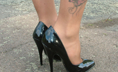 Stiletto Girl Donna Is Posing Outside In Her Very Horny High Heels And Short Skirt.