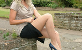 Stiletto Girl Gorgeous Blonde Kathryn Flashes Her Sexy Long Legs And Naughty White Panties, Whilst Racing Your Pulse Wearing Blue Stilettos