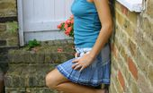 Only Melanie 234038 Blonde Melanie Wearing A Denim Miniskirt With A Blue Tight Top (Non Nude)