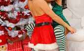 Only Melanie Sexy Santa Melanie And Her Little Helper Carla Unwrap Themselves For You.