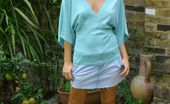 Only Melanie Melanie Relaxes In The Garden Wearing A Denim Miniskirt With A Turquoise Top And Sexy Miniskirt.