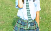 Only Melanie Melanie Takes A Wander In The Park Wearing A College Uniform Consisting Of Tartan Skirt