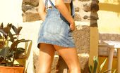 Only Carla 235105 Beautiful Brunette Carla Enjoys The Sun In A Casual Dungaree Minidress