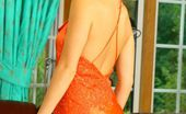 Only Carla Carla In A Stunning Orange Evening Dress