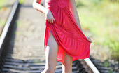 Nubiles Barbra Bubbly Nubile Barbra In Red Loose Dress Flaunts Her Innocent Look In The Railway