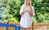 Nubiles Diana Fox Girl Next Door Blows Bubbles In Her Backyard While Nearly Naked