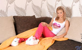 Nubiles Bibi Noel Teen Bibi Noel In White Shirts And Pink Pants Poses And Teases Us On The Couch