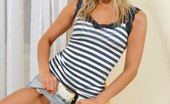 Nubiles Jessica Bee Lovely Blonde Pinup Pulls Up Her Denim Skirt And Reveal A Sexy Stripey Thongs