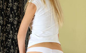 Nubiles Logan Bella Naughty Blonde Logan Bella Slowly Taking Off Her Jeans To Show Off Her Tight Round Ass On The Sofa