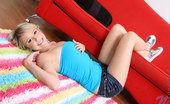 Nubiles Tessa Taylor Tessa Taylor Has Fun Teases Us With Her Charming Teen Beauty On The Red Couch