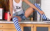 Nubiles Tinna Girl Next Door Shows Off Her Hot Body In Overalls And Knee Socks
