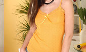 Nubiles Nikky Teen Nikky In A Orange Dress And Jeans Skirt Teases Us With Her Charming Beauty