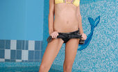 Nubiles Mia Perky Amateur Coed Slowly Stripping Her Two Piece Bikini While Posing At The Poolside